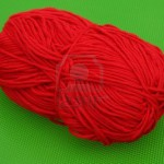 1954248-red-ball-of-yarn-on-green-background