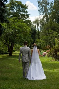 bride-and-groom-walking-in-a-park